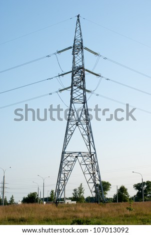 support of power line on blue sky - stock photo