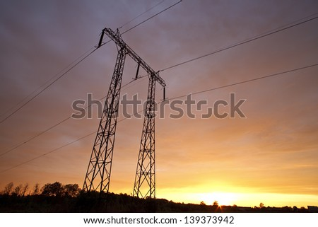 Support of power lines against the morning sky