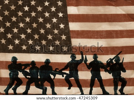 support our troops - a row of plastic army men against a worn flag - stock photo