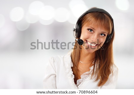 Support phone operator beautiful young woman in headset at workplace - stock photo
