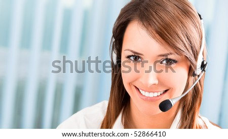 Support phone operator in headset at workplace - stock photo