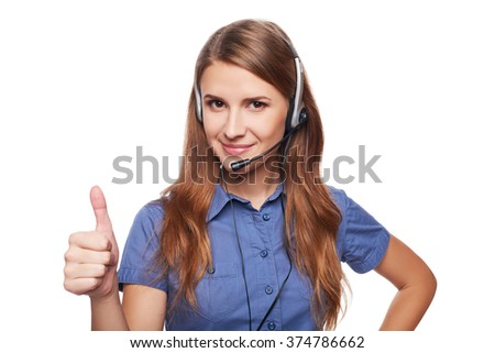 Support phone operator in headset smiling looking at camera and giving approving sign, isolated on white - stock photo
