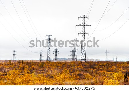 Supports high-voltage line. The tundra in the Arctic Circle - stock photo