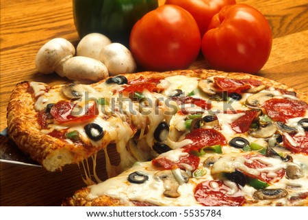 Supreme Pizza in pan - stock photo
