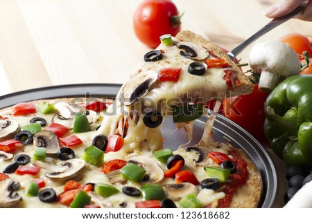 Supreme pizza slice lift - stock photo