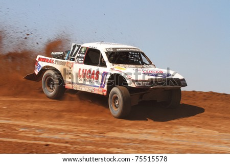SUPRISE, AZ - APR 16: Carl Renezeder (17) at speed in Pro 4 Unlimited Lucas Oil Off Road Series racing on April 16, 2011 at Speedworld Off Road Park in Avondale, AZ. - stock photo