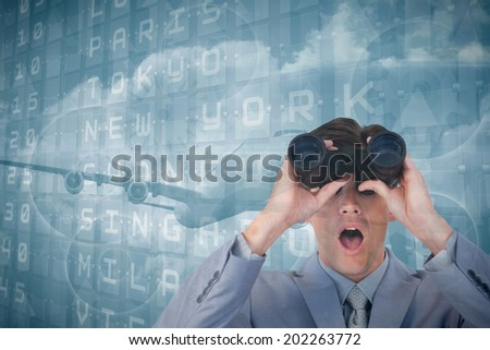 Suprised businessman looking through binoculars against departures board for major cities - stock photo
