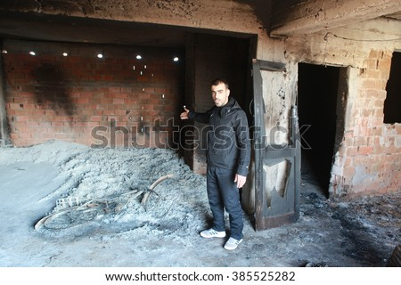 SUR, DIYARBAKIR - FEBRUARY 10: A building is seen just after it was hit by a mortar during clashes between Kurdish protesters and Turkish police. The Photo Taken February 10, 2016. - stock photo
