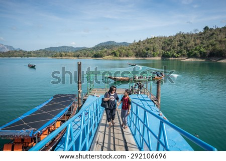 Surat Thani , Thailand - April 9,2015 : The tourist with long-tailed boat visiting lake and mountain at  pier in Khao Sok lake, Surat Thani Province, Thailand.
