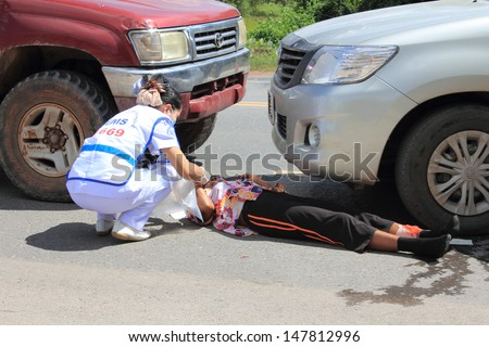SURAT THANI, THAILAND - OCTOBER 4 : Practicing fire protection plan and rescue car accident on October 4, 2012 in Surat Thani, Thailand.