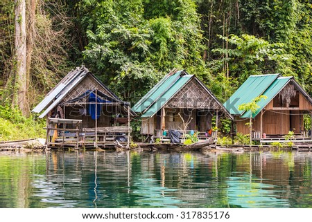 SURAT THANI, THAILAND - 12 SEPTEMBER 2015 - Lakeside cottages of native people in Cheow Lan reservoir in Surat Thani province, Thailand.