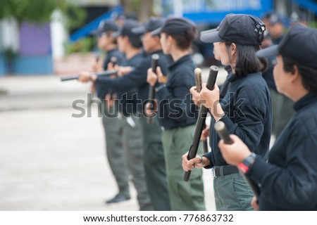 SURATTHANI THAILAND- Aug 28: Police women practice using batons to control riots at police schools. Aug 28,2017 in suratthani province,Thailand