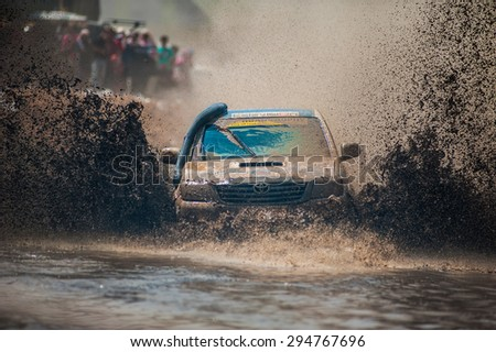 SURATTHANI THAILAND- Jan 25: Unknown riders during the off-road racing rally of this rally for charity and free fee for everyone. Jan 25,2015 in Suratthani ,Thailand - stock photo