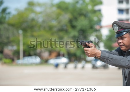 SURATTHANI THAILAND- Jul 13: Polices practice riot controlling using a shield and a truncheon training tactical differentat police training academy. Jul 13, 2015 in suratthani province,Thailand - stock photo