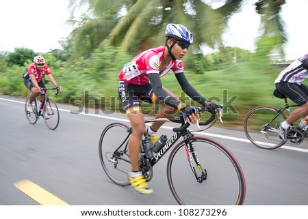"SURATTHANI, THAILAND - JULY 8: Unknown riders in action during ""Suratthani bike race 2012"" at Suratthani on July 8, 2012 in Suratthani, Thailand."