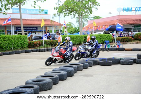 SURATTHANI, THAILAND - JUNE 21, 2015: Unidentified contestant in Yamaha One Make Race and Yamaha Automatic.Yamaha cull young consistently Activities Yamaha Cup Race 2015 Round 2.