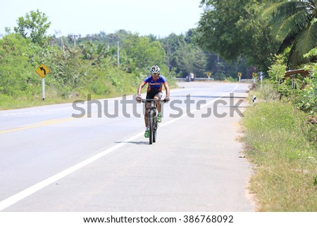 SURATTHANI, THAILAND - MARCH 6, 2016: Unidentified contestant in bikes Racing and Model race 120 km.Tour of Police 8 Activities Bikes Race 2016 Round 1. - stock photo