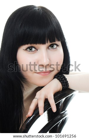 Sure beautiful woman in  sitting on a chair on a white background