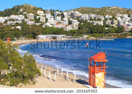 Surf beach on the shores of the Aegean sea, Vouliagmeni, Greece - stock photo