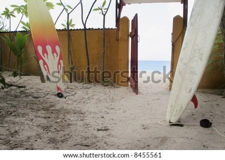 surf board on tropical beach - stock photo