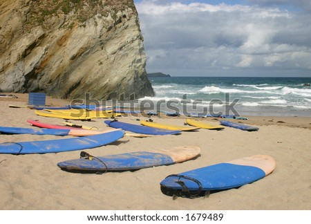 Surf boards on beach, Newquay, Cornwall - stock photo