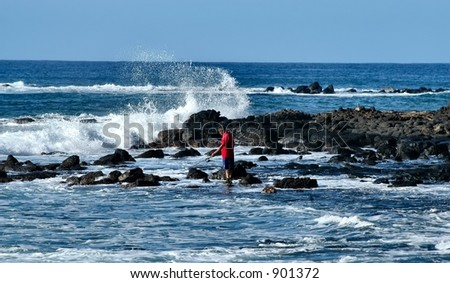 Surf fisherman #1 - stock photo