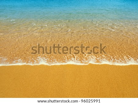 Surf on a tropical beach - summer background
