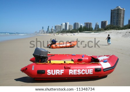 Surf rescue boats on Southport beach looking towards Surfers Paradise on the Gold Coast Australia. - stock photo