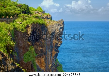 Surf waves and turqoise water along the coast of Bali - stock photo