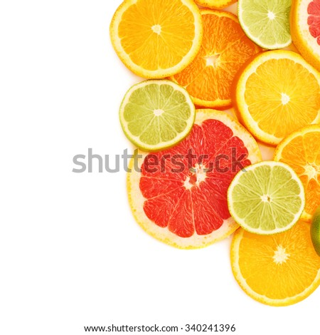 Surface covered with citrus sliced different fruits over white isolated background - stock photo