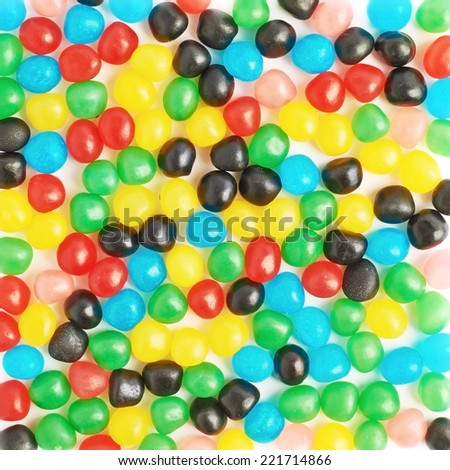 Surface covered with multiple colorful candy ball sweets as a background texture composition - stock photo
