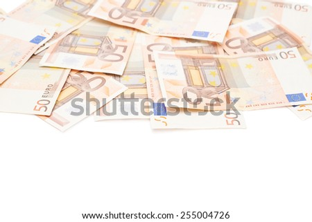 Surface covered with multiple fifty euro bank notes isolated over the white background