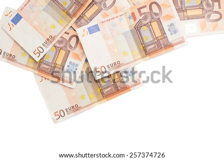 Surface covered with multiple fifty euro bank notes isolated over the white background - stock photo
