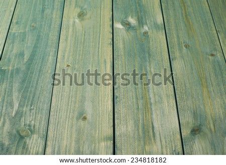 Surface covered with the multiple green paint coated pine wood boards as a shallow depth of field background composition - stock photo