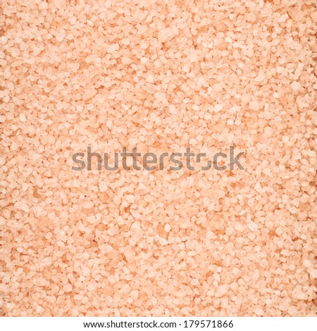 Surface covered with the pink colored salt crystals as a background - stock photo