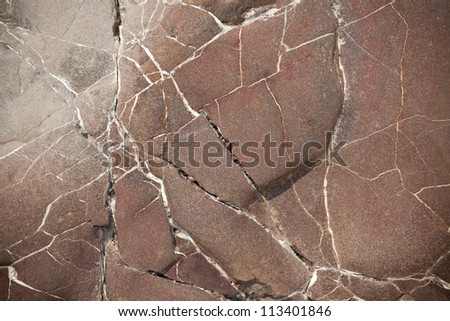 Surface of a large brown stone with cracks - stock photo