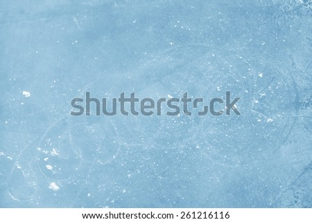 Surface of an Ice Rink Replete with Skate Marks - stock photo