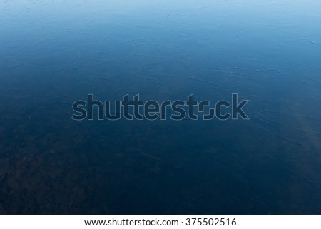 Surface of clean ice on a frozen lake in winter. - stock photo
