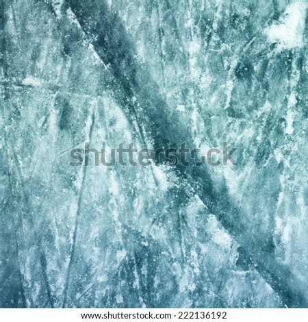 Surface of Outdoor Ice Rink Replete with Skate Marks. Ice Background. - stock photo