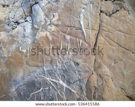 surface of the marble with brown tint, stone texture and backgro