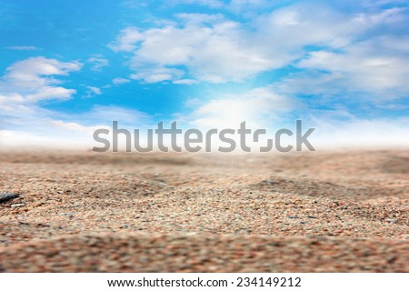 surface of the sea beach with a pile of sand and sky - stock photo