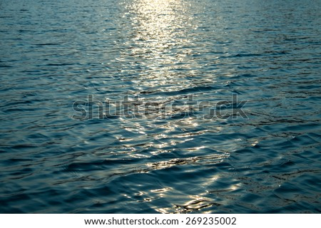 Surface of the water with sunset