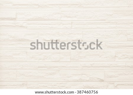 Surface white wall of stone wall gray tones for use as background. The new design of modern stone wall sepia. pattern of decorative brown stone wall surface. - stock photo
