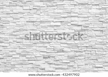 Surface white wall of stone wall gray tones for use as background. The new design of modern stone wall. pattern of decorative stone wall surface. - stock photo