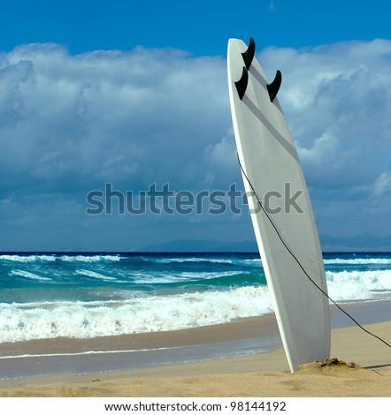 Surfboard on Fuerteventura beach - stock photo