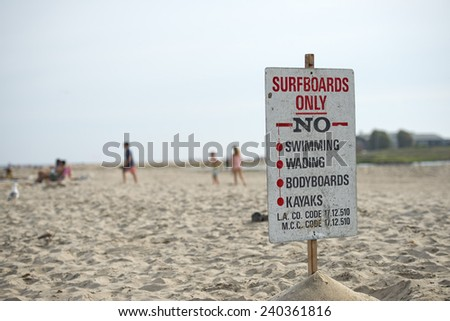 Surfboard only sign on malibu beach
