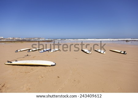 Surfboards in the sand - stock photo