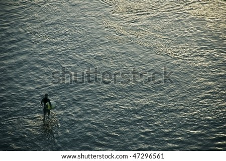 Surfer and the surface of the sea. Bali. Indonesia. - stock photo