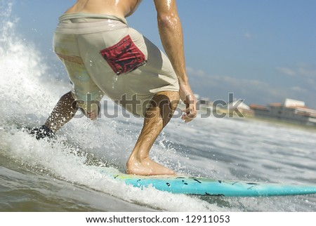 Surfer catching a wave. Close. Half body - stock photo
