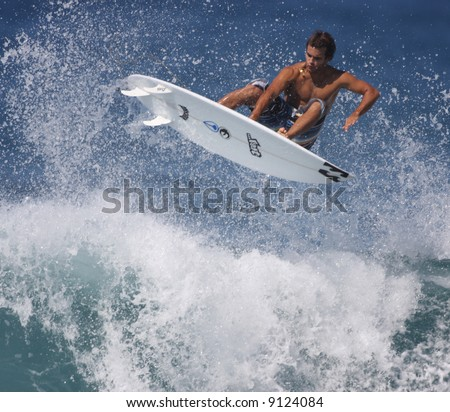 surfer gets air - stock photo